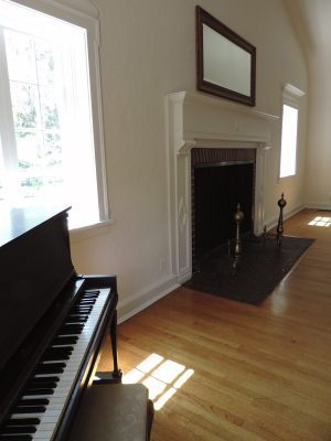 Piano and fireplace