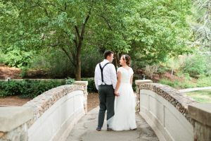 Bride and groom at bridge by Callie Hobbs