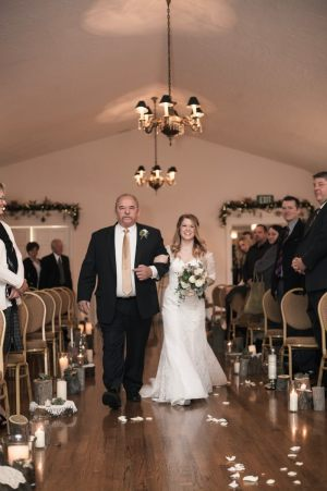 Bride and father at indoor ceremony by Duston Todd