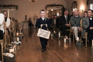 Indoor ceremony boy by Duston Todd