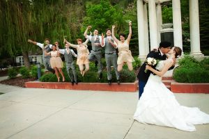 Wedding party at white monument by Abbey Kyhl